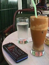 Frappe and Cell Phone: add a pack of cigarettes and a lighter and you have the Athens Survival Kit