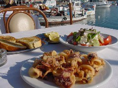 Kalamaraki and Greek salad, restaurants in Microlimino harbor Pireaus